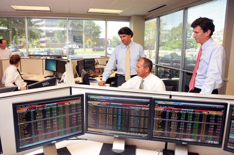 Gary Wunderlich and Philip Zanone, standing, with former Morgan Keegan employee Stephen Iskalis at Wunderlich Securities' new trading desk.