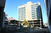 A parking garage is under demolition at 147 Jefferson, where a mixed-use development is planned.