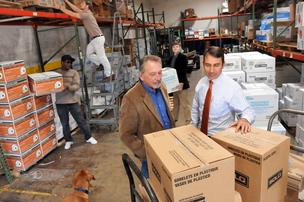 Ron Pinner and Todd Farris check shipments while Lonnie Smith, Jadrian Labbs and Michael Douglas work at Apollo Distribution, which merged with E.H. Clarke & Brother.