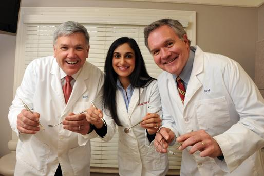 James Avery, Nishel Patel and Dan Meadows operate their dental practice in a former home on Walnut Grove Road.