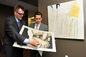 John Weeden looks over a piece of art with Northwestern Mutual Financial Networks managing partner Jim Meeks.