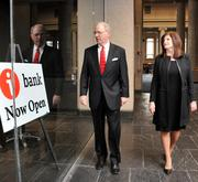 Chip Dudley and Susan Stephenson stroll past Independent Bank's new branch in One Commerce Square lobby area.