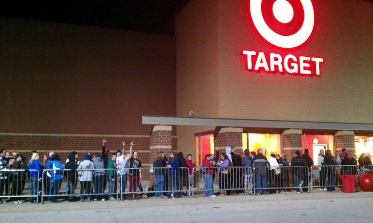 Shoppers lined up outside a Target store in 2012 in anticipation of Black Friday deals. This year, the retail giant — like many others — will open even earlier, at 8 p.m. Thanksgiving Day.