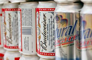 "Beer lovers are accusing Anheuser-Busch of watering down its Budweiser, Michelob and other brands. Anheuser-Busch InBev called the claims ""groundless."""