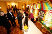 """Guests register before entering the """"Candy Factory"""" at the Pfister Hotel."""