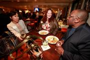 (From left) Melinda Toy of Bank Mutual, Susan Davis of UBS Financial, Troy Davis of Melthouse Bistro