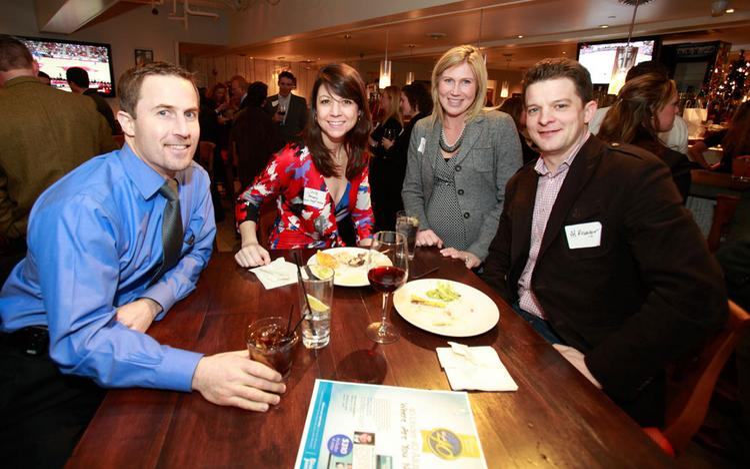 Dr. Michael Gordon (far left), at a recent Business Journal function.