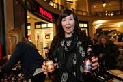 Ashley Brandt, brand strategy director of Art Milwaukee, hands out Point beer at the event.