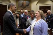 New Glarus Brewing Co. president Deb Carey shook hands with President Barack Obama during a visit to the White House in November to talk fiscal cliff issues.