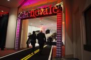 """The """"Carnevale"""" sign over the entrance into the convention center hall."""