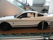 A 2009 Shelby GT 500, with just 11,000 miles.