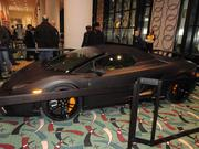 There are many exotic cars on display.