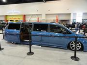 A mini-van limousine is on display at the show.
