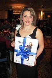 Anna Bakalinsky of Mila's European Bakery displays her award