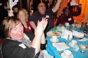 Guests at the IndependenceFirst table cheer for the winners.