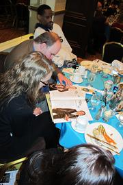 Guests read the profiles of the winners in the awards special section.