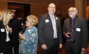 (Center) Teig Whaley-Smith of Community Development Advocates LLC and Perry Huyck