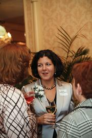 40 Under 40 winner Rebecca Cameron Valcq of We Energies chats with guests.