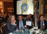 Guests at the American Family Insurance table watch the awards being handed out.