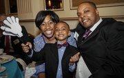 40 Under 40 winner Erickajoy Daniels of Brady Corp. and her family.