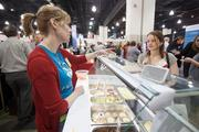 Stephanie Harris of LaCoppa Gelato serves up a sample to Alice Evans of Downhill Coffee.