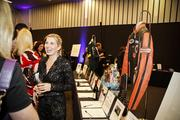 A networking reception and silent auction was held before the fashion show.
