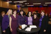 A group of employees from Park Bank, all wearing purple to honor the cause.