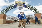 Fans stop to pose for a photo on the way into Miller Park.