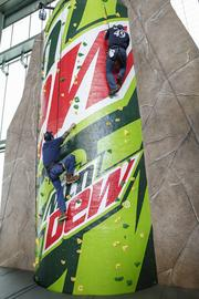 Climbers try out the new climbing wall on the Dew Deck.