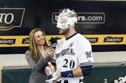 Lucroy gets a shaving cream pie in the face from teammates during the interview.