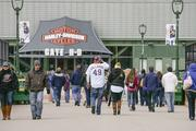 Fans enter the Harley-Davidson Inc. entrance to Miller Park.