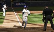 Brewers second baseman Rickie Weeks scores the winning run in the 10th inning.