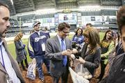 Attanasio signs autographs before the game.
