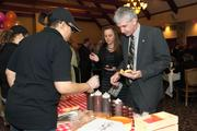 Guests try samples from Pat's Rib Place.