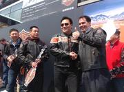 Walker shakes hands with Harley-Davidson fans in China.