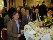 A group of executives at the J.P. Cullen & Sons Inc. table.