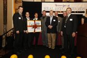 "Ingeteam and MSI General Corp. executives accept the ""Project of the Year"" award."