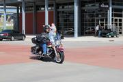 A rider arrives for the annual shareholders meeting.