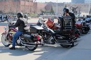 Riders dismount before the Harley-Davidson annual shareholders meeting.