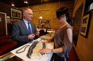 (Left) Sam Hill of Rohr Jewelers Inc., which is known for its pearl offerings. Click here for story