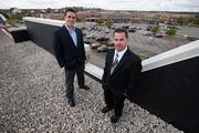 (From right)) Steve Johnson, property manager for Brookfield Towne Center, which was recently purchased by Phillips Edison for $15.4 million, and David Roth, leasing manager for Phillips Edison & Co. Click here for story
