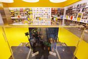 """A """"Brand Ribbon"""" runs the circumference of the store, featuring Lego model displays, company history and fun facts."""