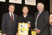 (Center) Matt Rinka of Rinka Chung Architecture Inc. receives the award for his firm.