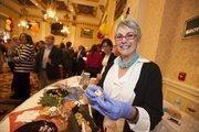 Martha Davis Kipcak of Martha's Pimento Cheese hands out samples.