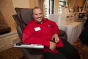 Rick Roeglin of Senior Helpers tries out a massage chair.