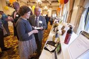 (Left) Terry Rex of Horizon Home Health Care and her husband, Scott Rex, of Marquette University Business School look over auction items.