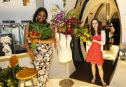 Pius High School students Nyla Wilson and Anna Van Gheem in the Fashion+Botany=Michael Gaffney exhibit.