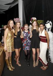 Several fashion designers from Pius XI High School.