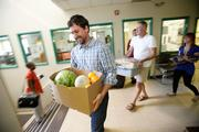 Bill Ledger carries food for The Guest House. Click here for story