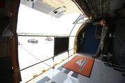 Senior Master Sgt. Patrick Sosinski opening the aircraft doors after landing.